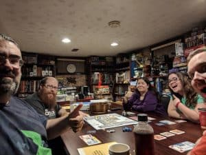 A happy bunch of board game players after a fun night of playing The Thing