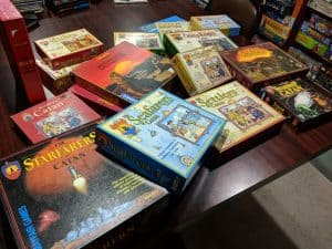 Lots of Catan boxes.