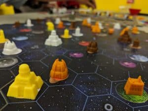 A close up of the board game player components in Gaia Project