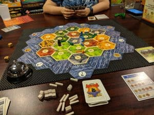 Catan, a board game with many board game bits.