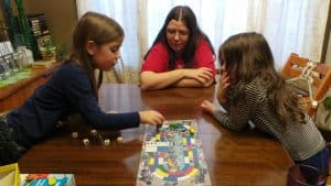 Mom playing Monza a great board game for toddlers and preschoolers.