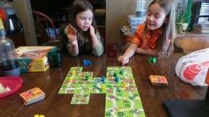 Two girls playing Kids of Carcassonne the fantastic board game for children.