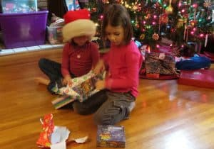 Girls opening board games Christmas Morning