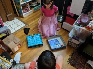 Girls playing the board game Magic Labyrinth