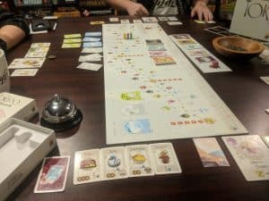 Playing the board game Tokaido during game night.