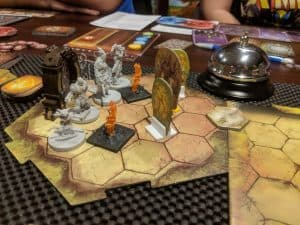 A mid game picture of Gloomhaven, the number one game in the world.