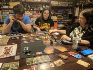 Three gamers playing the number one game in the world Gloomhaven.