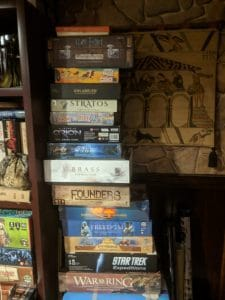 Stack of unplayed board games.
