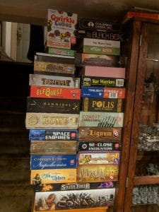 Large stack of unplayed board games.