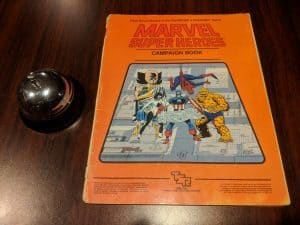 The very orange campaign book for the TSR Roleplaying Game Marvel Super Heroes