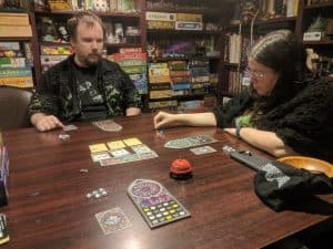 Three Player Sagrada and abstract board game about building stained glass windows.
