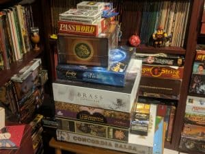 One of my piles of unplayed board games.