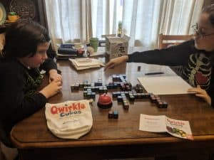 Playing Qwirkle Cubes with kids.