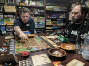 Three players playing the board game Scoville from Tasty Minstrel Games. This game play included the expansion Scoville Labs.
