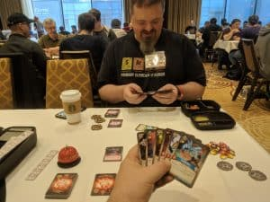 Sean out podcast host playing Keyforge.