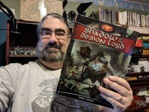 The Tabletop Bellhop with his copy of Shadow of the Demon Lord