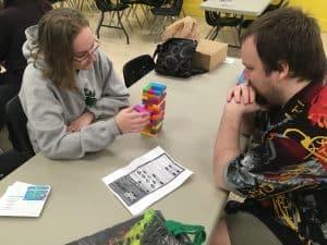 Two gamers playing Jenga.