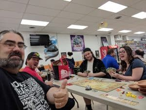 A group of gamers having fun playing ZhanGuo at the FLGS