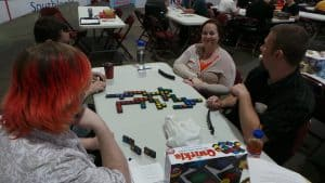 Gamers playing Qwirkle