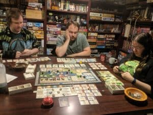 Gamers playing the board game Gentes from Tasty Minstrel Games.