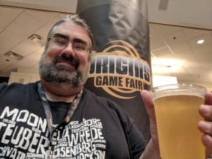 Enjoying a beer at the big bar on 2 at Origins.