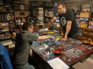 Two players playing the board game Twilight Imperium Fourth Edition.