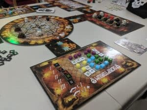A close up shot showing off the amazing components in the board game Dead Man's Cabal from Pandasaurus Games.
