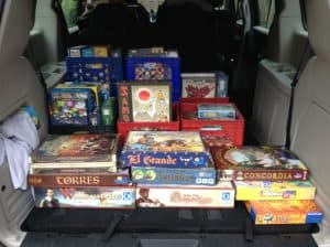 A van all loaded up with board games for a club game night.