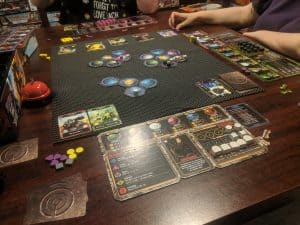 Three players playing the boardgame Horizons