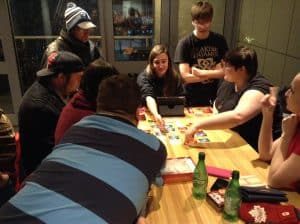 A group playing Codenames at The Green Bean.