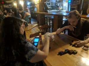 Qwirkle Cubes being played at the QCC VIP party.