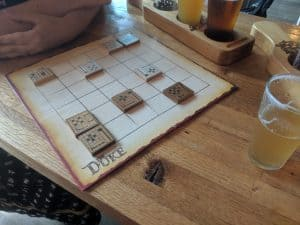 Playing the chess like abstract strategy game, The Duke, at a local brewery.
