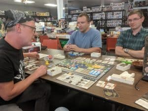 Playing the board game Gentes during an Extra Life gaming marathon.