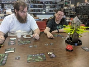 Players testing their sanity playing the push your luck game Tower of Madness.