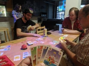 Playing the card game Bohnanza with some new gamers at EZY Mode.