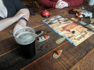 Playing the board game Imhotep at a brew pub.