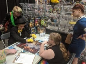 A group of Harry Potter fans playing the Harry Potter FunkoVerse Board Game.