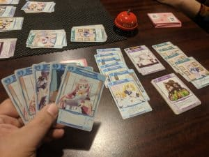 An in play shot of the card game Tanto Cuore showing off the unique Chambering system.