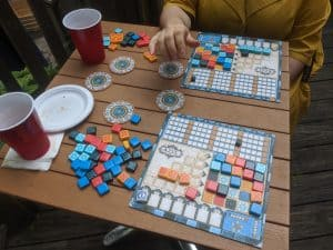 Two player Azul being played outdoors at a wedding.