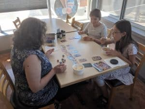 Mim playing king of the dice - King of the Dice, a Great Kids' Push Your Luck Dice Game from HABA - Review