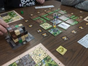 Playing the board game Minecraft Builders & Biomes from Ravensburger