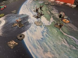 A picture of a game of X-Wing being played.