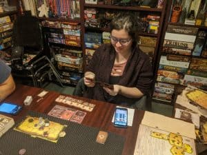 Kat picking her cards for the Gloomhaven Berserker Solo Scenario