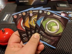 A hand or the new role cards added to Eminent Domain in the Escalation Expansion for playing with 5 players.