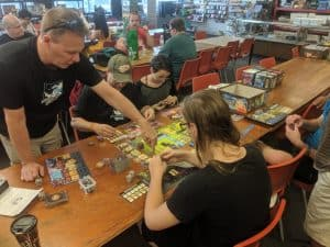 Ryan Iler teaching Quodd Heroes at The CGRealm a FLGS in Windsor Ontario