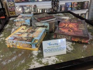 Donating unwanted board games to a local charity auction.
