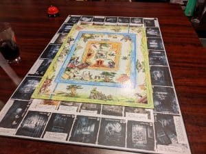 The board for Talisman The Magical Quest Game on top of the board for Talisman Batman Super-Villains Edition