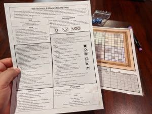 All you need to play Roll for Lasers a Roll and Write Game