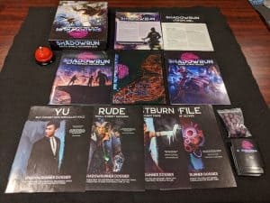 The contents of the Shadowrun Sixth World Beginner Box from Catalyst Games Labs.
