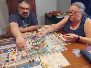 Me teaching my mother in law how to play Vinhos Deluxe.